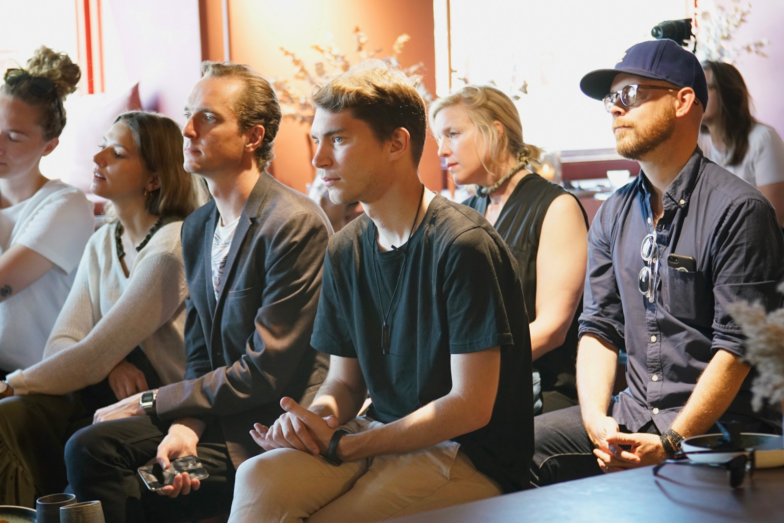 Event photography: Spectators at Creative Mornings Cph - shot with Lomography Neptune